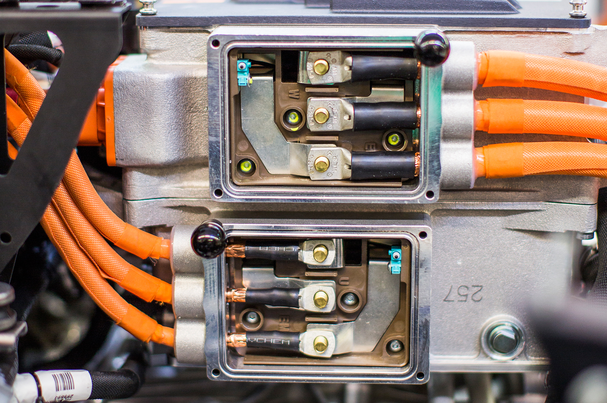 And here are the electric inverters, which reside, somewhat inelegantly, on top of the dual-clutch transmission.