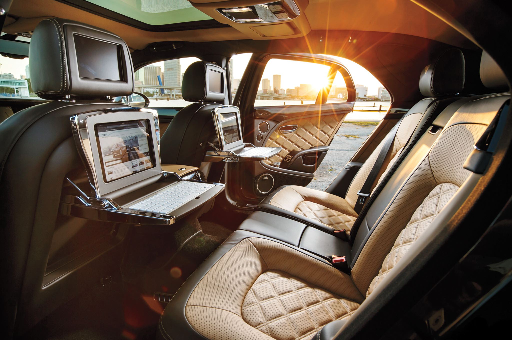 En route to Davos or Cannes, owners can tap on fold-down iPads in a roughly $400,000 mobile office.