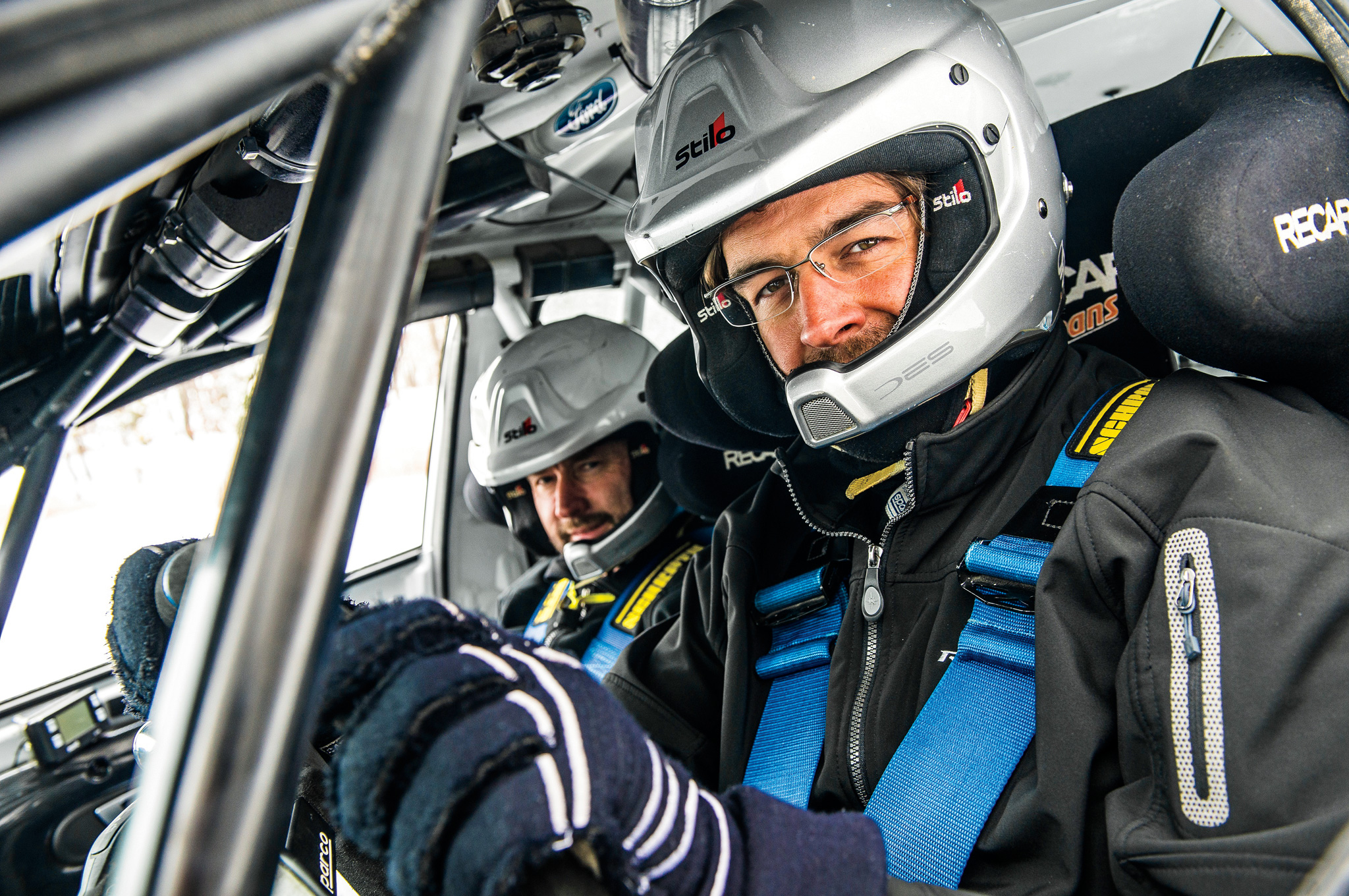 Driver Andrew Comrie-Picard and navigator Ole Holter wear helmets with integrated mics so they can hear one another over Team O'Neil's No. 20 Ford Fiesta ST rally car.