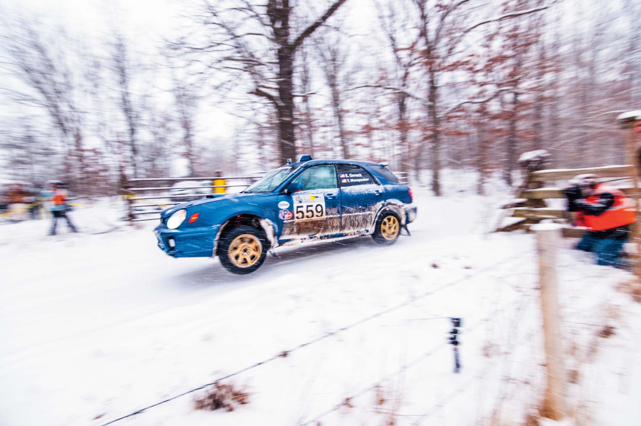 Seeing rally cars fly through the air is almost as awesome as driving our own car on Missouri's snow-covered back roads.