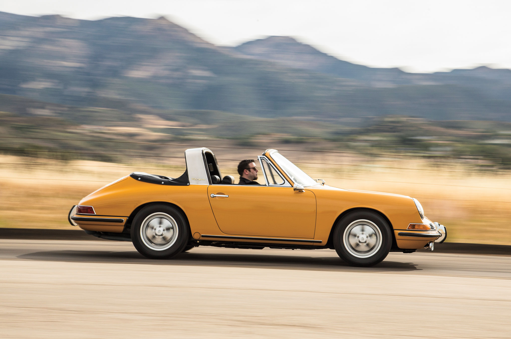This vintage 911S looks fabulously '60s with its Bahama Yellow paint and classic five-spoke Fuchs wheels.