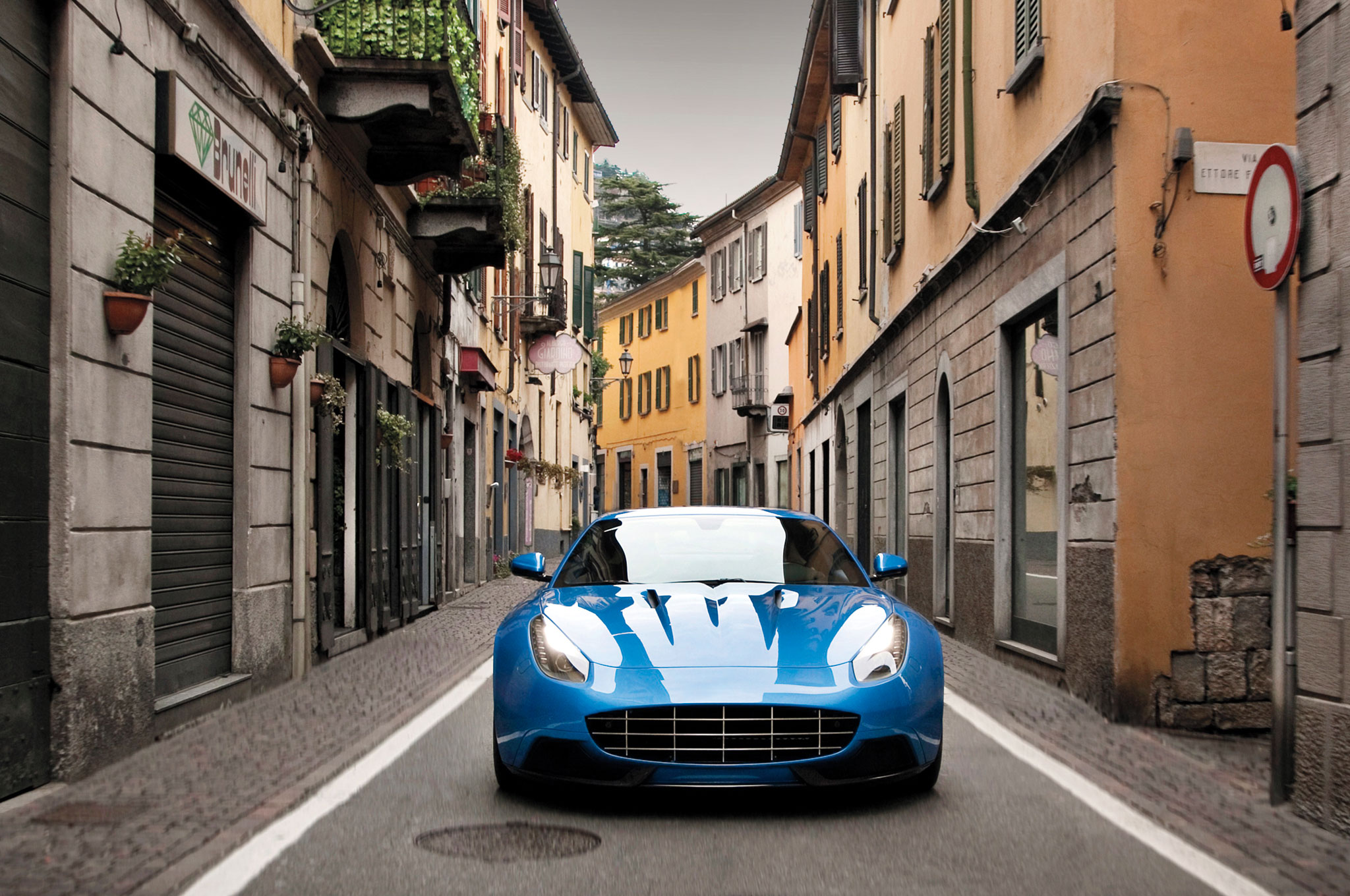 A finely tailored suit of new clothes has been draped over the chassis of a Ferrari F12, from sleek aluminum exterior panels to luxurious interior upholstery.