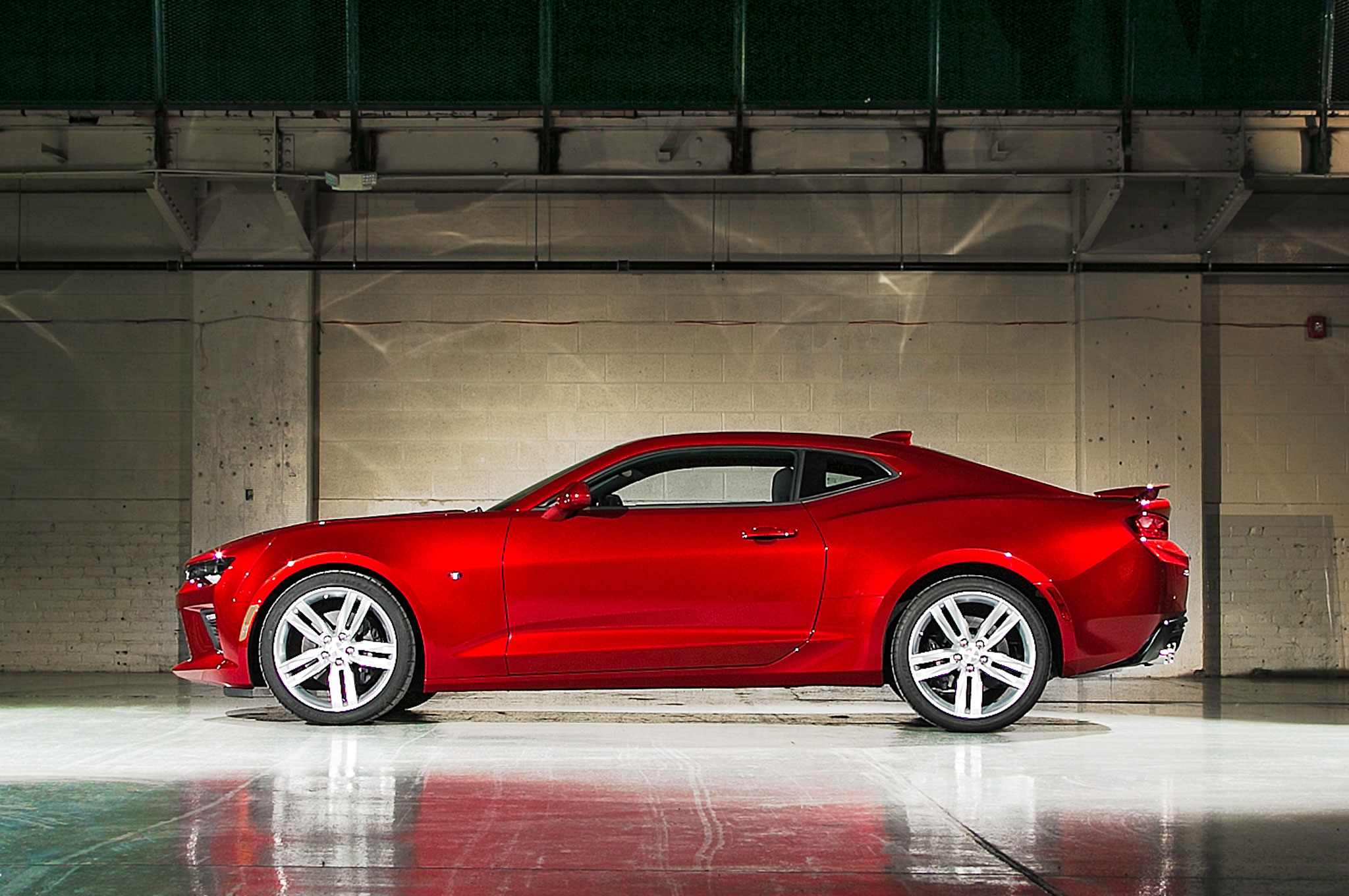 The new Camaro's more sculpted bodywork hints at the big weight loss from the outgoing model, middle. If the indents on the side were any deeper, the door wouldn't be able to open.