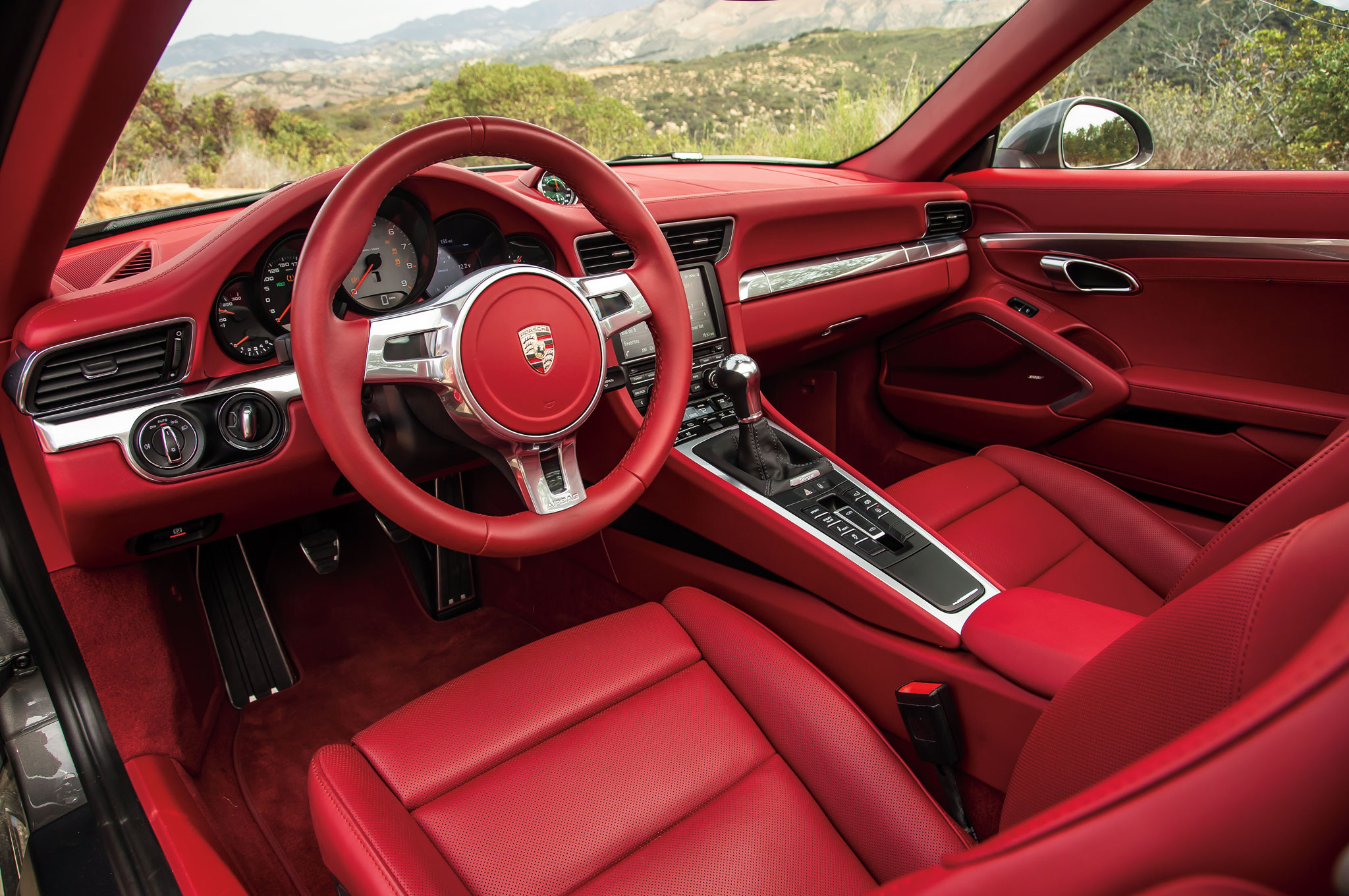 The new Targa interior seems inspired in equal parts by the early 911 and a Boeing 747 flight deck.