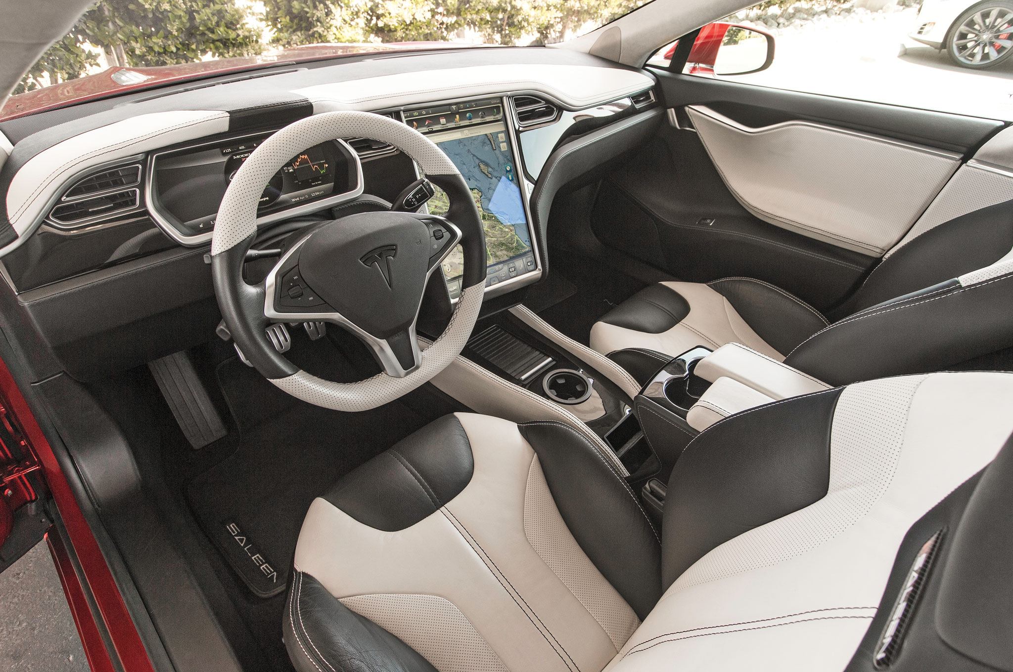 The GTX's slick cabin comes with a cupholder–an item missing in the first-gen Model S. Yes!