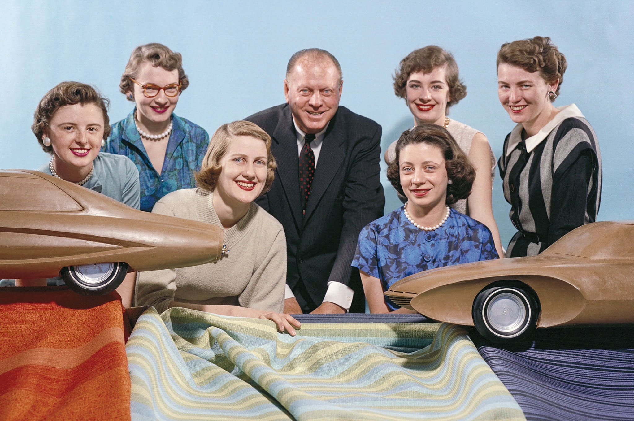GM designers, clockwise from left, Sue Vanderbilt, Ruth Glennie, styling chief Harley Earl, Jeanette Linder, Peggy Sauer, Sandra Longyear, and Marjorie Ford Pohlman.