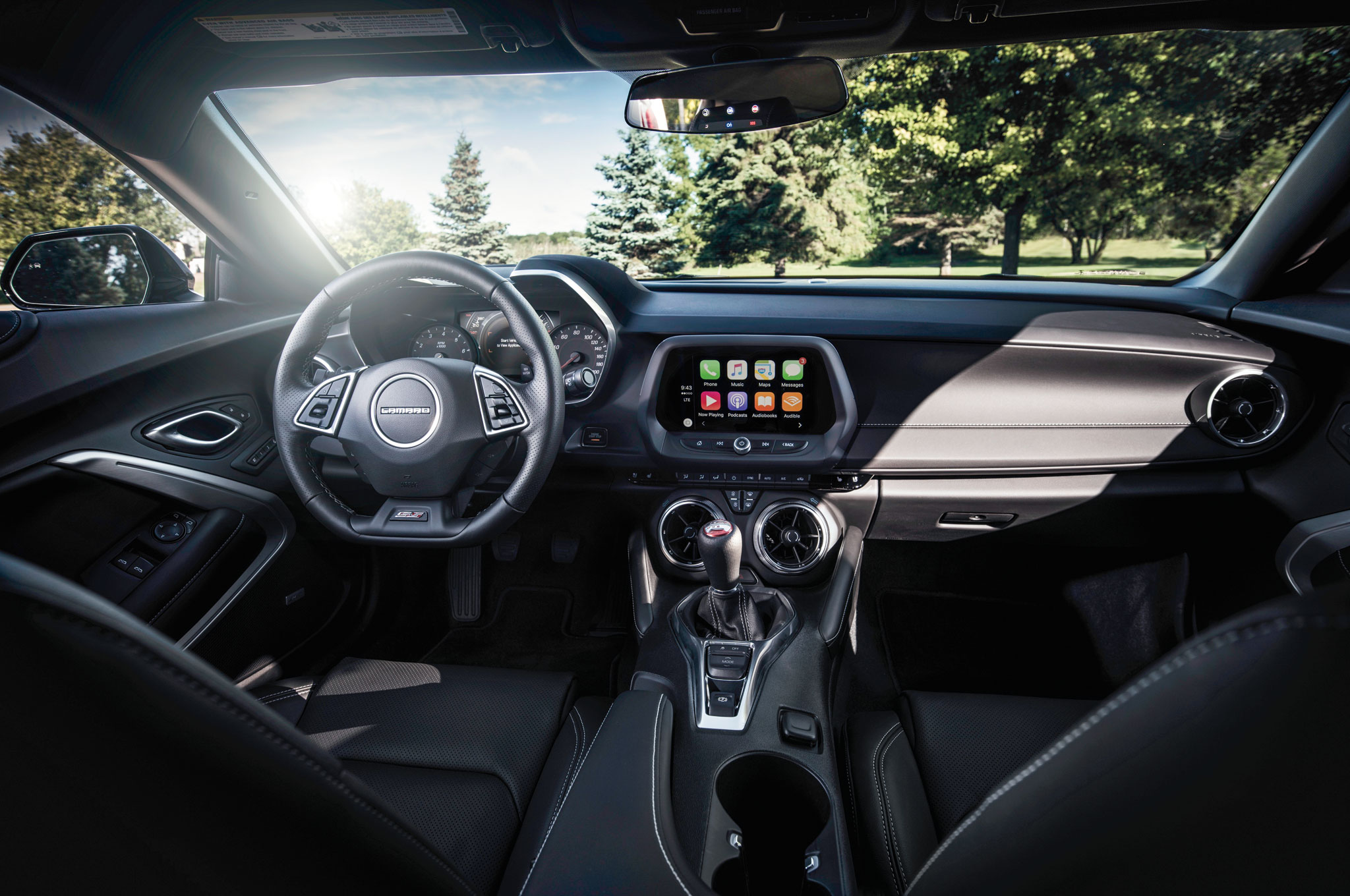 Inside the lean new Camaro, you'll find a tech-friendly, modernized interior with a flat-bottom steering wheel.