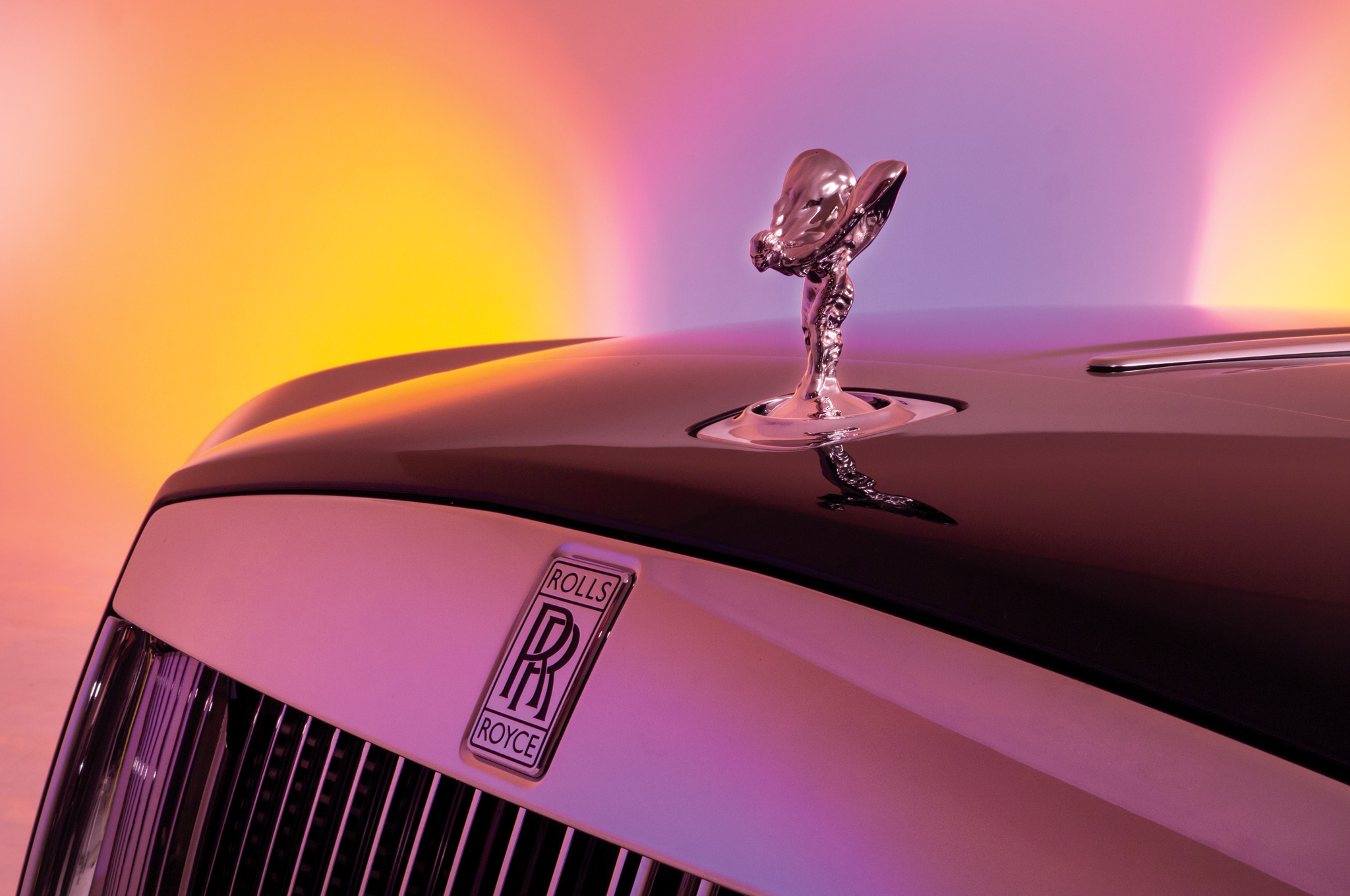 The Spirit of Ecstacy hood ornament is available with four optional finishes: solid silver, gold-plated, illuminated, and up-lit.