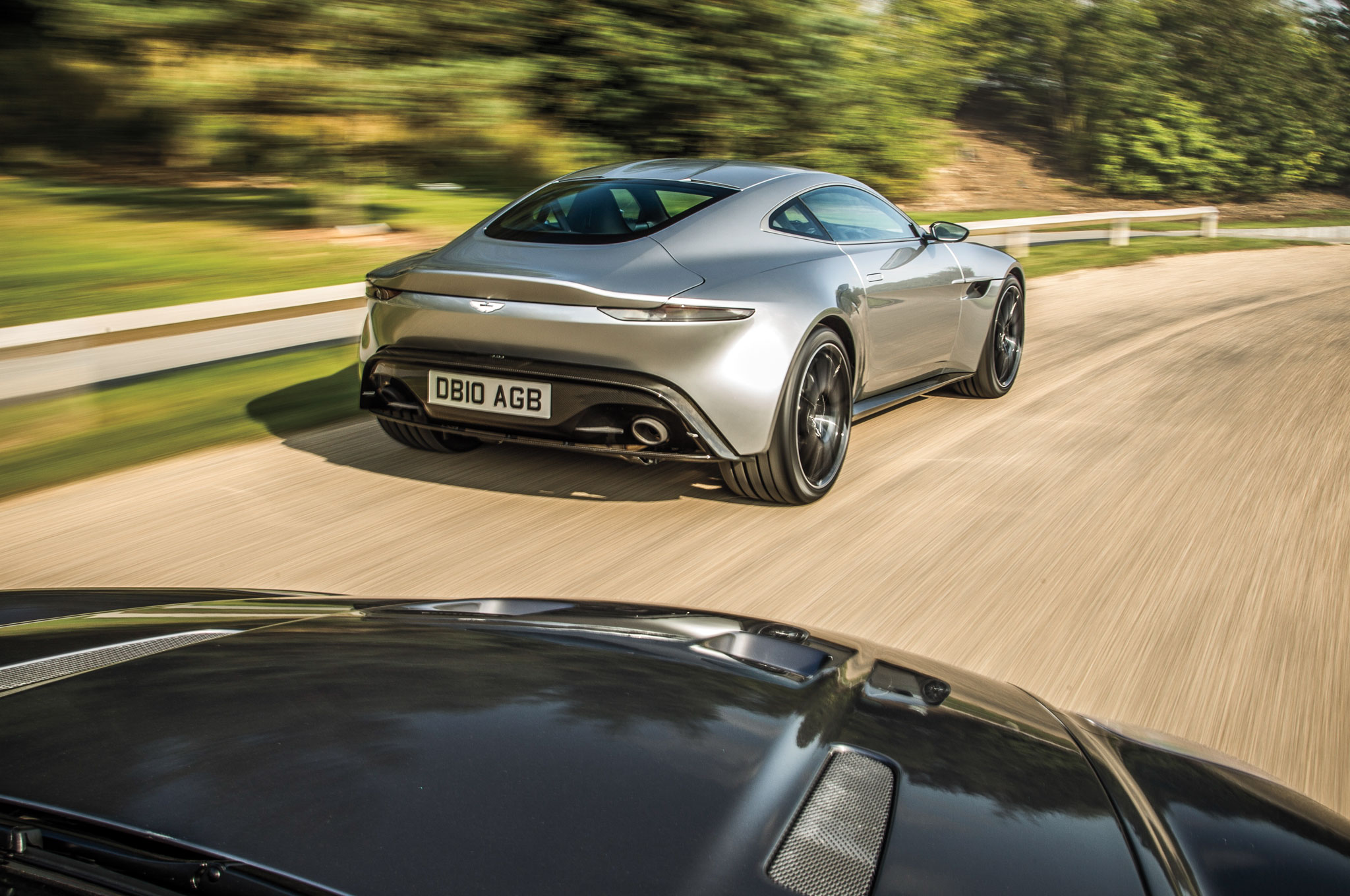 The DB10's beautifully thin and elegant back end wraps around to two huge, aggressive rear haunches.