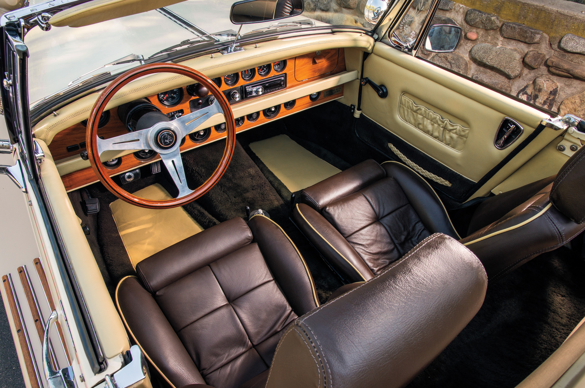 Handcrafted details were the stock-in-trade of neoclassics such as the Clénet Series I, including the teak shift knob for the three-speed automatic, plush leather seats, and horns, lots of horns.