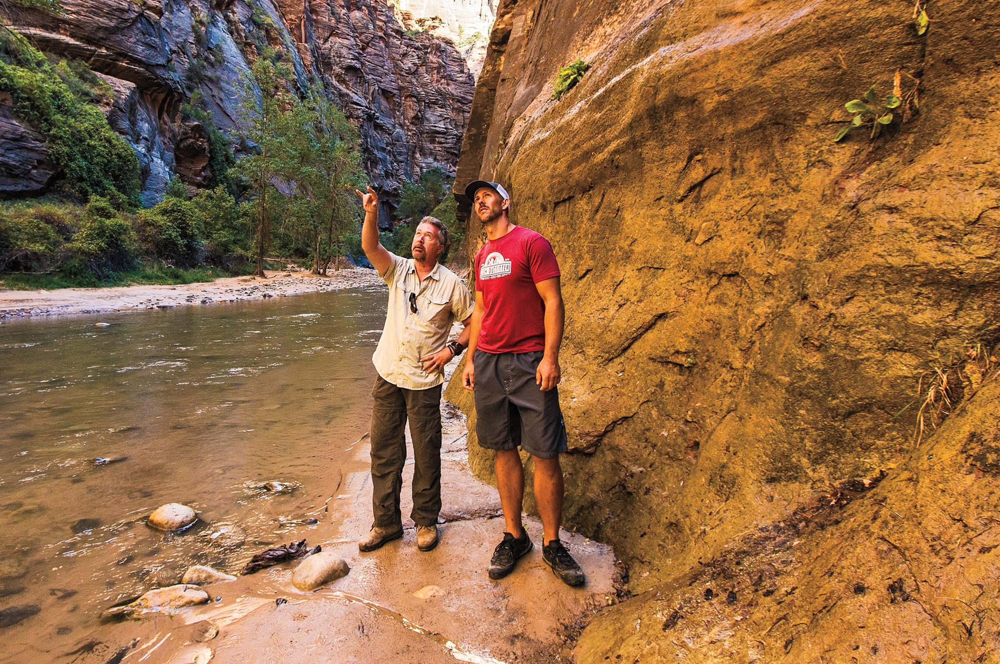 St. Antoine and guide Jim Frandsen scrutinize the jagged walls of Zion Narrows.