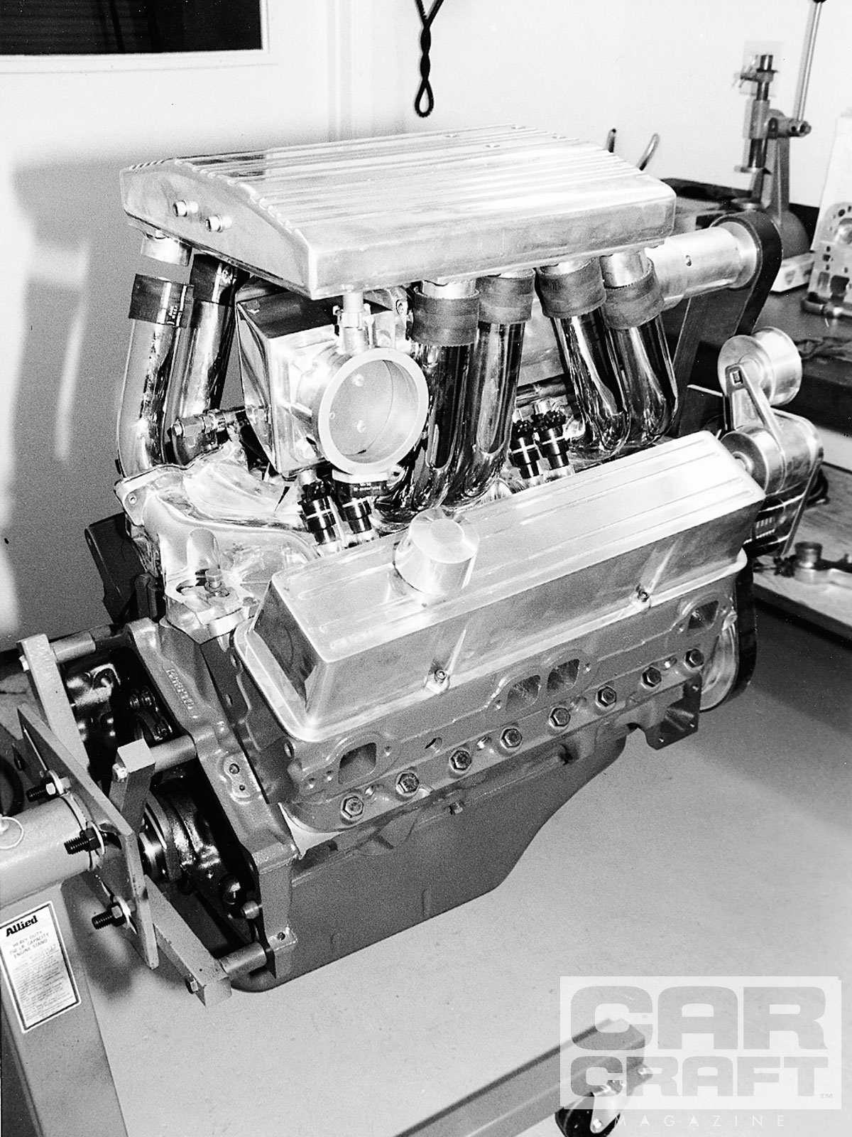 This custom-fabricated intake for a blown small-block Chevy features a common plenum and individual tubular runners. Just like an adjustable exhaust system, the length can easily be altered to fine-tune the engine's torque band.