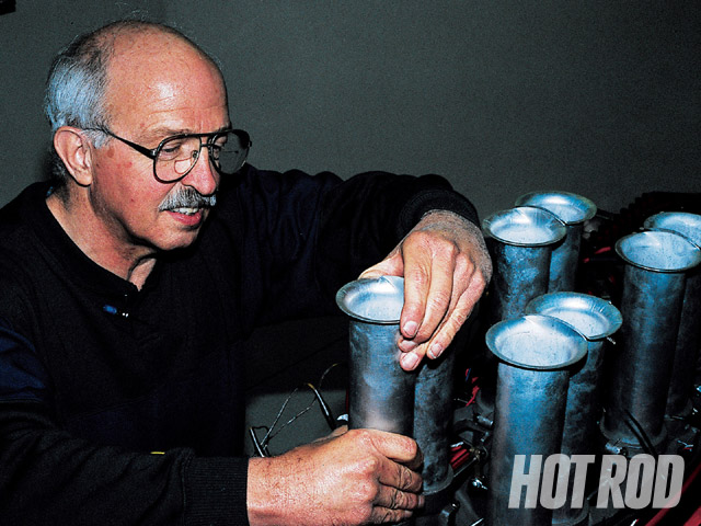 Bill Shope was studying for his master's degree in automotive engineering at the Chrysler Institute in 1958 when a lunchtime discussion with other engineers resulted in the formation of The Ramchargers. Here, Shope prepares to make a ram-tube length adjustment.
