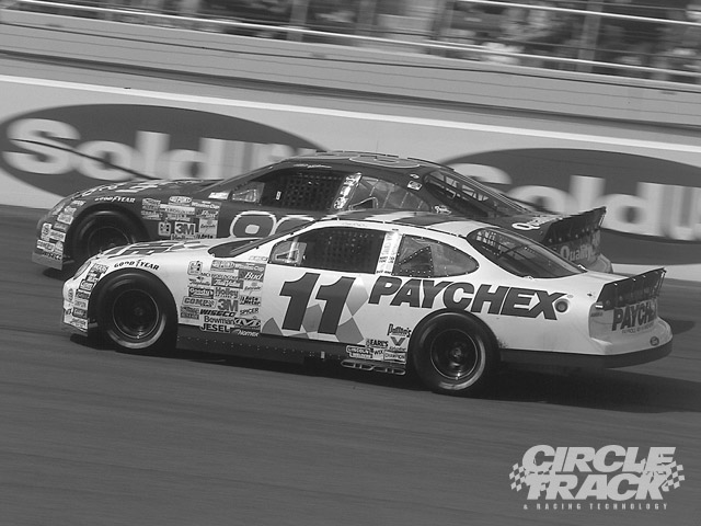 Bodine battles Dale Jarrett at Las Vegas Motor Speedway--where he finished 20th.