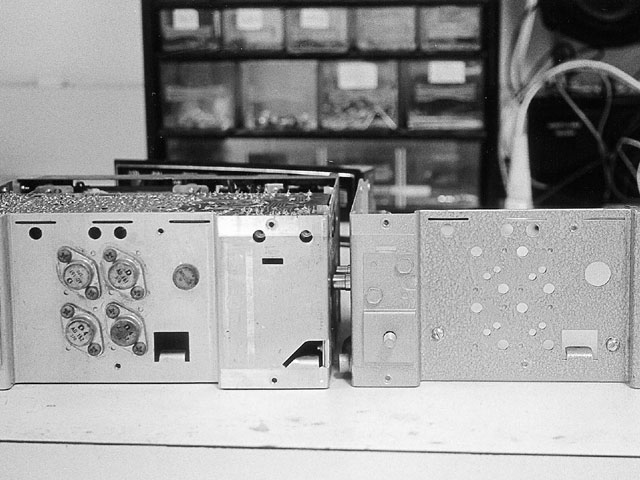 This is what the inside of your radio looks like. There's a lot going on in there! After the radios are taken apart, the chassis and tuner head are stripped of all their components. Photos B and C show the radios before (left) and after (right). Also notice that the chassis in photo C has been stripped and painted with a baked-on finish. This particular radio chassis is made of aluminum, but most are steel, and this finish exactly matches the gray hammertone finish we've seen on other examples.