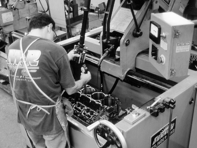 Piston-to-wall clearance is critical, and each bore is carefully checked with a dial bore gauge during the honing operation. The cylinders were finished for our Total Seal moly rings, which take a finer finish than cheap cast iron bore eaters.