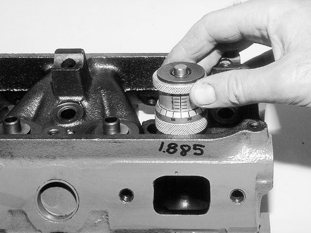 Using the height micrometer is done by substituting the mic for the spring and unscrewing it until it takes out all the slack. The scale reads the installed height directly.