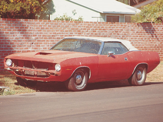 Though it runs good, this old Mopar looked like a heap. It will have to wait its turn for a full resto, but we'll at least make it look respectable in the meantime by fixing the paint. We know, the AAR hood isn't correct.