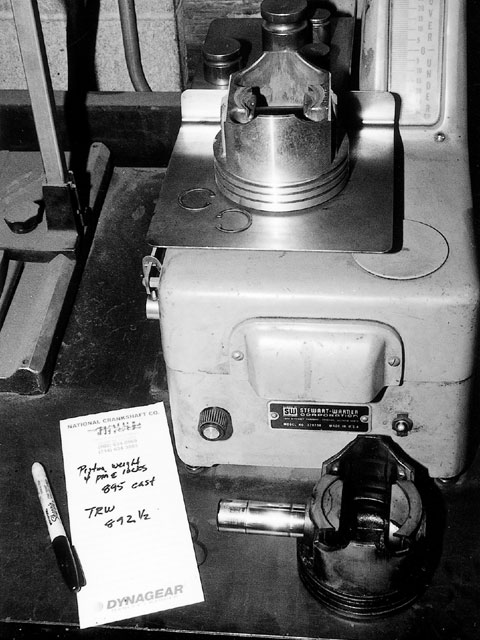The engine had obviously been custom balanced as part of the last rebuild. We weighed our new TRW pistons and compared them to the old cast-replacement pistons and found them within 2.5 grams. We subtracted the weight of the carbon and varnish on the old ones and decided they were probably bang-on. The weights were much closer than production tolerances, so we opted not to rebalance the engine.
