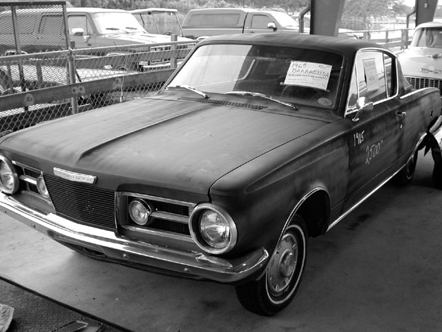 This little Barracuda was for sale for $2,500 and was complete with a later 318. Overall, the car looked OK, but closely inspect it for bodywork because of the fresh coat of primer. Always be cautious but not ignorant with the owner.