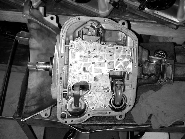 With the 727's pan removed, you can see the valvebody. Remove the 10 bolts that hold the valvebody in place. After you remove the bolts, lift the valvebody out while moving it forward to release the Park position detent rod.