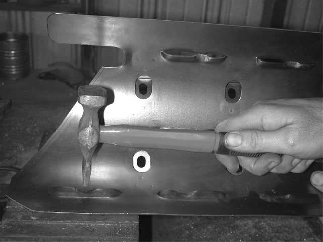We found that with the pan on, the edges of the tray were pushed in slightly, enough to cause a clearance problem. Some hammerwork with a notched bar of steel backing it up had the tray clearanced for the 4-inch stroke.