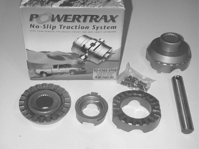The Powertrax is a component kit, which replaces the gears in a stock differential case with a locking differential. An inner coupler replaces the side gear and splines onto the axleshaft. The coupler's straight-cut drive teeth on its face side match the teeth on the driver, which is pinned to the case with a heavy shaft. An active spacer between the two works through a syncro system to allow the differential to lock and unlock.