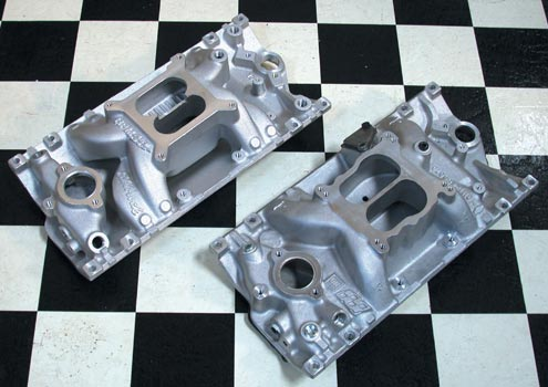 Here's the GM EGR intake (front) compared to the Edelbrock Air Gap, which is about 1/2-inch taller. The RPM Air Gap manifolds have runners that are separated from the engine's valley pan to keep hot oil off of them. That's more of a benefit in the car than on the dyno, but we've found the Air Gaps to be just slightly more powerful than the standard Performer RPMs in either case. A Vortec-style intake manifold is required for the HT383 engine, but we were able to reuse the original intake gaskets.
