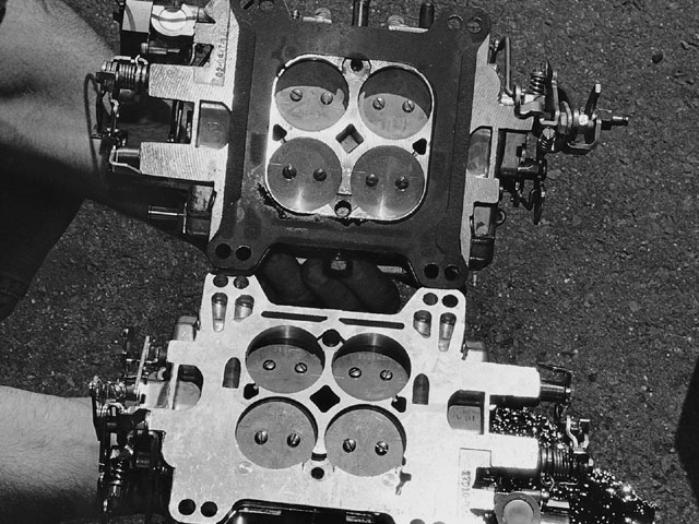 From underneath, the 750 (top) has smaller throttle plates; the 1 3/4-inch butterflies on the 800 are the largest-ever for Edelbrock's style of square-bore carb. Should you decide to place it on a stock intake, the casting's throttle bore openings will need to be hogged out to maintain smooth airflow; we recommend making the intake swap as well.