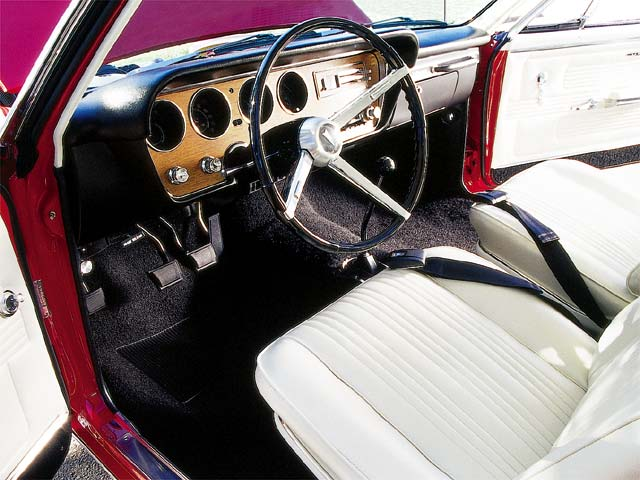 To a 17-year-old gearhead, this was as plush as it could get. Over 30 years later, Parchment bucket seats cradle Ed as the Hurst 4-speed shifts his thoughts to the past.
