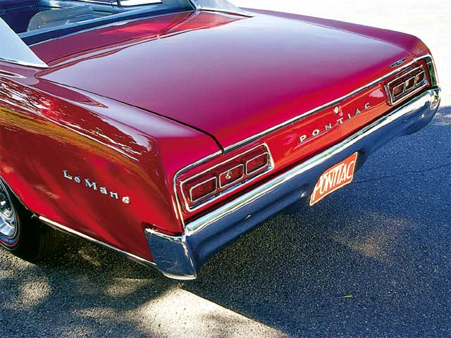 The exterior trim pieces were re-chromed and bolted up; that hard-to-find exhaust system was coated since the separate parts were different colors than the original pipes.