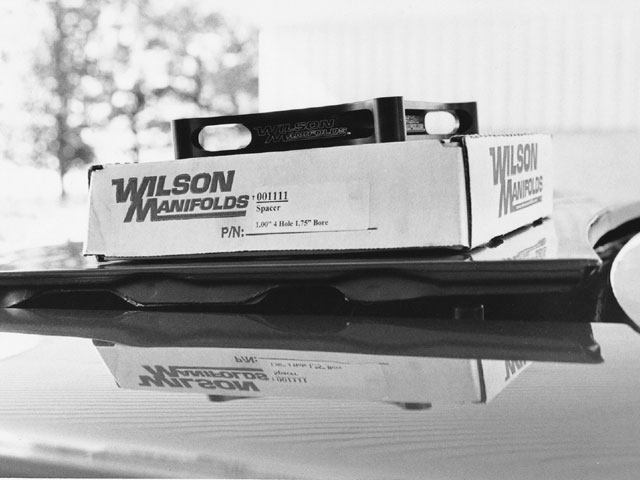Our Wilson Manifold spacers were all one-inch thick, creating some hood clearance problems. For our scoopless Dodge, the easy fix was to adjust the hood hinges for an added 1.5-inches at the cowl.