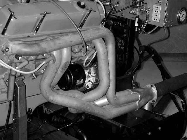 03. With our baseline numbers in, we stripped the factory Hi-Po manifolds from the heads. Some will argue that on a mild engine combo, the factory iron exhaust doesn't give anything up to headers. We felt otherwise. A well-used set of Hooker 17/8-inch SuperComp dyno headers were bolted on. Power climbed to 355 hp, with a near constant torque gain across the entire curve. That's a meaningful improvement.