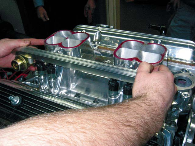 7-Once the injectors are in the rail, the entire unit can be pressed into the bosses in the intake manifold.