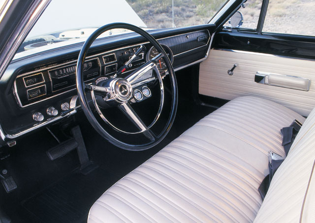 The impeccable interior remains stock down to the bench seats, save for abrace of mechanical Auto Metergauges and an Auto Meter tach. Gear selection is controlled by the stock column shifter.
