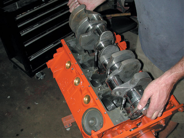 Aftermarket stroker cranks have become popular, opening the door for a whole new world of engine-size combinations. Here, a 4.000-inch stroke crank is being dropped into a 360 block to replace the 3.580-inch original stroke to create a 408-cube small-block.