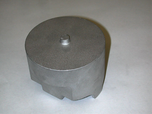 Forged pistons begin as blanks created by pressing a lump of aluminum into a die under the extreme pressure of a forging press. This raw blank from Probe illustrates the great deal of material that needs to be whittled away to make a piston.