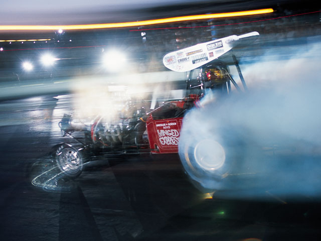 This replica of Wild Willie Borsch's AA/Fuel Altered is a regular on the nostalgia racing circuit. Another Reunion highlight is the cacklefest, where the vintage fuel-burning front-engined dragsters light up the twilight sky with eye-melting fumes.