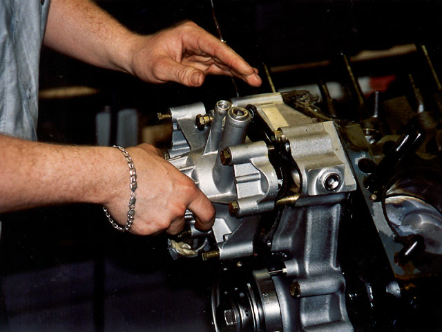 The harmonic balancer had to be honed in order to fit over the crankshaft. The water pump-also a standard part-was installed.