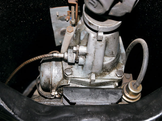 The speedometer cable, which ends at the driven gear, is threaded to the transmission tailhousing, as shown on this GM TH350. It is readily accessible.