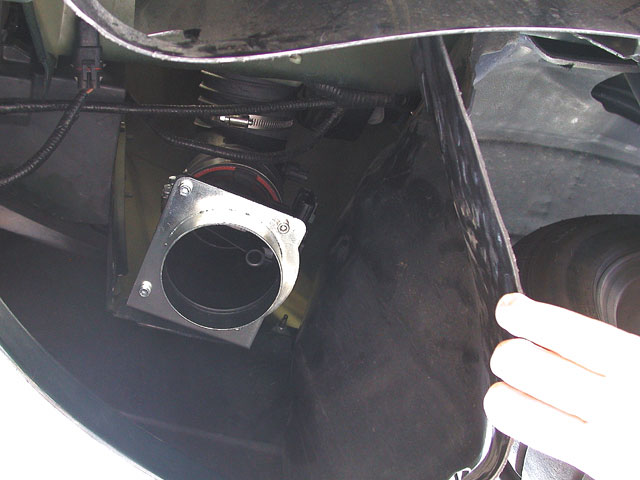 You'll ditch all the stock inlet junk with the exception of the mass airflow sensor (MAF), which gets relocated into the passenger fenderwell using ducting and a K&N air filter provided in the Paxton kit. The instructions say the wiring for the MAF needs to be cut and lengthened, but JBA Racing has found that you can just cut the tape off the wiring harness and free enough extra wire to reroute the plug without cutting anything.
