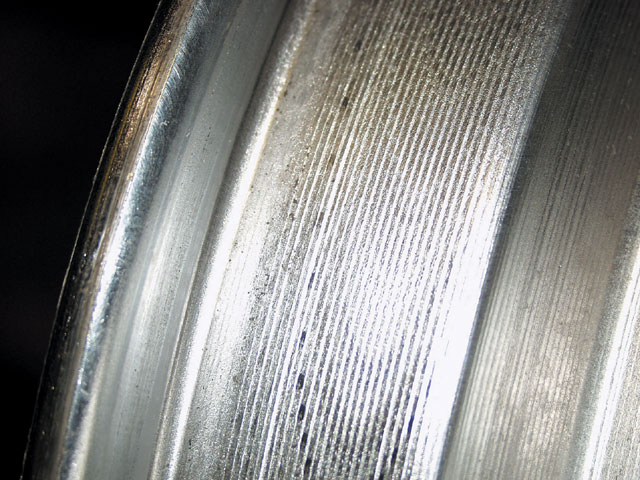 Here we can see the area of a spun wheel between the middle and the rim. This process promotes a lighter wheel while serving to produce areas of increased thickness where we need the strength. The spun process also insures that the run-out is forced to be correct for a true form as far as roundness and conformity in material thickness.