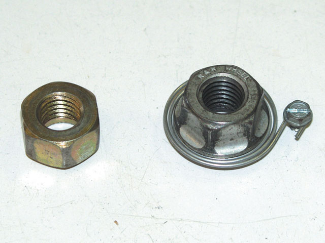 A standard lug nut is shown on the left next to a spring mounted lug nut. Note the flange on the back side of the spring nut. This helps locate and center the socket more square to the nut reducing the chance of the nut turning sideways and sticking in the socket.