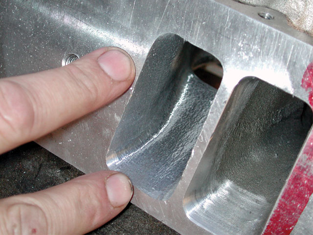The dogleg wall and floor are shown here after cutting. Note the smooth radius away from the pushrod pinch and down the runner to the bowl, as well as the minimal material removal from the floor.