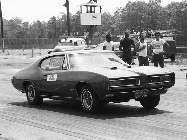 Here is Martyn at the strip with a press pool '68 GTO running in the D/Stock Auto class. Note the manufacturer's license plates of the day that start with the letters GM. Martyn noted that the GM lawyers didn't take to kindly to Cars magazine's printing photos of GM cars with their tags at the strip. Remember these were the days of high insurance premiums for high performance cars and all manufacturers were beginning to downplay their roles in drag racing.