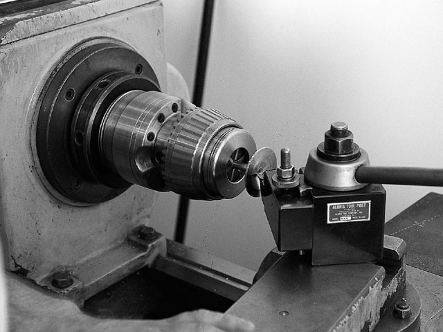 Even if you aren't allowed to grind in the combustion chambers, you can make specific (although small) adjustments to combustion-chamber volume by dishing the valves.