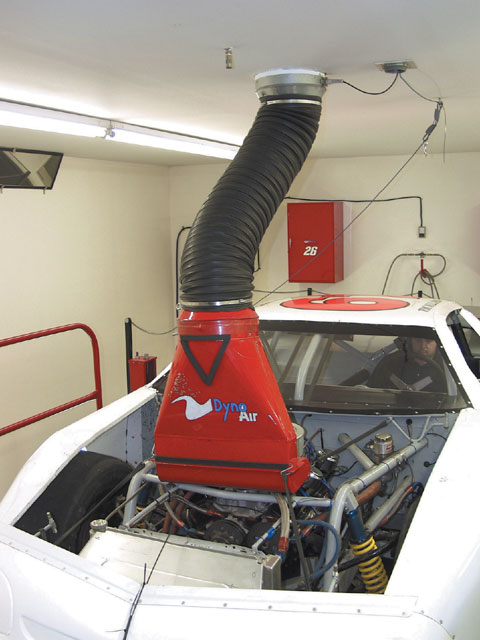 The inlet on the left is one that is used with the Winston Cup car's air cleaner box. The car's air box is turned around and fitted tightly to the fresh air supply fixture.