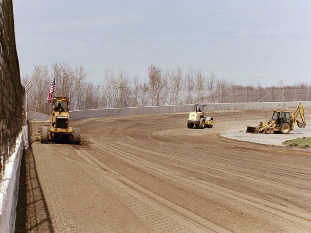 Construction crews carved out the new 4/10-mile oval, which was built to give the lower-budget racers a chance to showcase their driving skills.