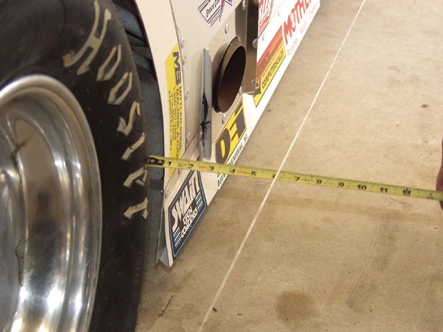 When using the string method, set the string height at hub height and align the string with the framerail. Measure to the tire bulge at the front and rear to make sure the rearend is square to the chassis. Adjust the trailing arm lengths to make the rearend perpendicular to the framerail. Once the runout is eliminated from the wheel in Step 1, this method becomes fairly accurate. Be sure to place the tape measure against the tire sidewall, away from any raised lettering.