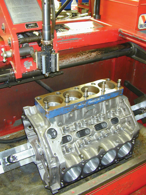 After the block is pre-tested and bored to spec, it is put on the Sunnen CK-10 mill and honed. The torque plate bolted to the deck will make all the difference in the world when the engine is finally assembled, as the bores will have been honed with the exact stress the head fasteners place on the structure of the block when the head is installed.